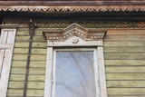 Traditional wooden Russian carved platband and a window