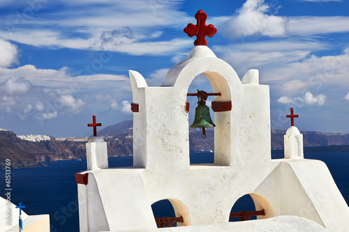 Bell tower of church against the  Santorini island, Greece.