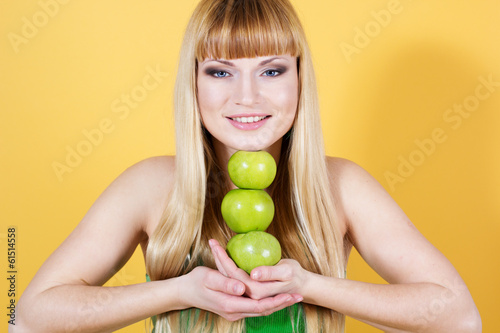 pretty girl with green apples