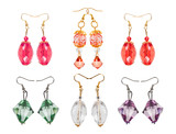 Earrings made of glass on a white background. six pairs