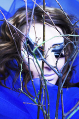 Young woman and twigs