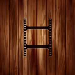 Film web icon. Filmstrip symbol. Wooden texture