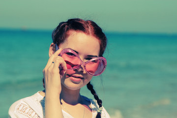 Portrait of beautiful woman with pink sunglasses