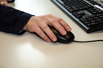 hands on mouse and keyboard