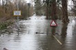 Flood sign in road - 61517951