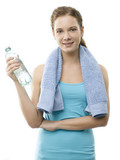 Young woman after workout against white background