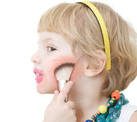 little girl applying blusher