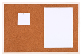 two sheets of paper on bulletin cork board