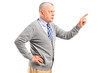 Angry mature man pointing with finger and threatening