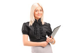 Blond businesswoman holding a clipboard