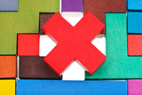 cross shaped block on wooden puzzle