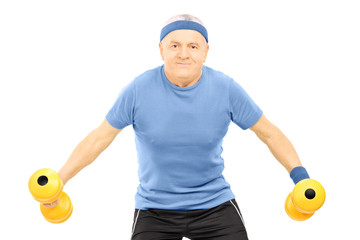 Mature man in sportswear exercising with dumbbells
