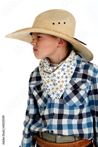 Young cowboy with a sneering expression wearing a huge cowboy ha
