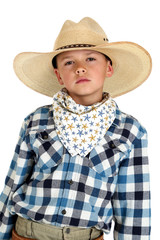 Young cowboy with a serious look wearing a large hat