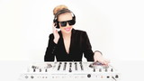 Beautiful sexy blond DJ in sunglasses