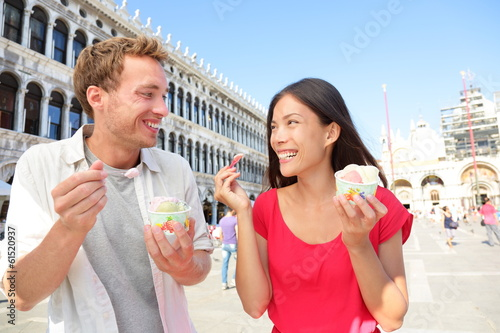Couple eating ice cream on vacation, Venice, Italy