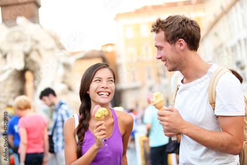 Leinwandbild Motiv Ice cream - couple eating gelato in Rome