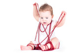 Funny baby girl playing with red pearls