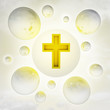 christian golden cross with glossy bubbles in the air with flare