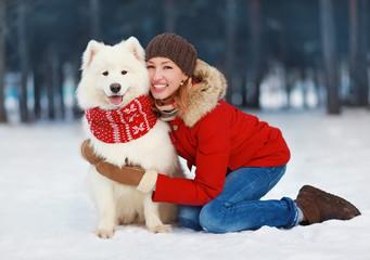 Joyful beautiful stylishly dressed young woman in red jacket hug