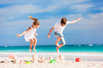 Two kids crushing sandcastle