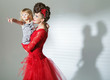 Elegant brunette lady with cheerful child