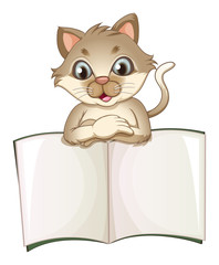 A brown cat opening an empty notebook
