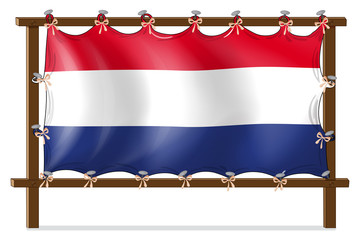 The flag of Netherlands attached to the wooden frame