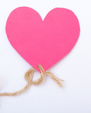 Pink paper heart with string symbol love valentine's day