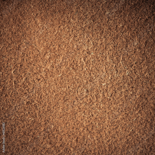 Brown textured leather skin grunge background closeup
