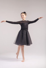 Young girl in the dance pose