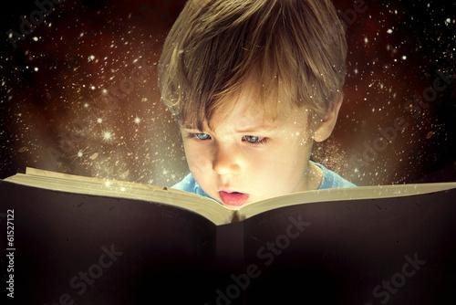 Leinwanddruck Bild Little boy and the magic book