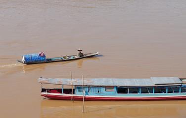 Fisherman in boat at Mekong river. Luang Prabang. Laos.
