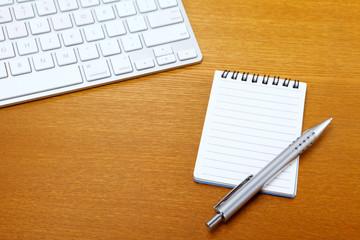 Notepad and computer keyboard