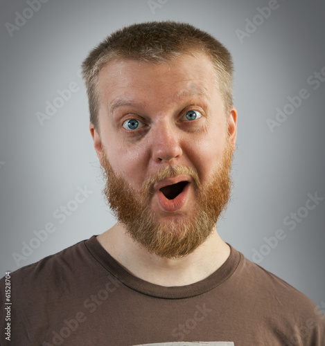 Man with an expression of surprise on his face