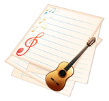 An empty music paper with a guitar