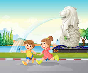 Two kids playing near the statue of Merlion