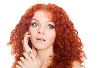 Beautiful red haired girl with a surprised look