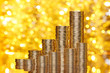 Golden coins stack on bokeh background