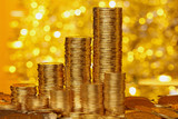 Coins stack on golden bokeh background - 61530550