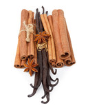 Vanilla, cinnamon and star anise spices isolated on white
