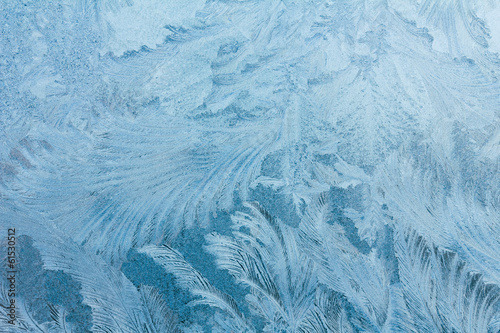 Frosty ice pattern on winter window glass