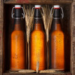 Beer bottles with wheat stems in old wooden crate still life