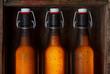Beer bottles with vintage swing tops in old wooden crate