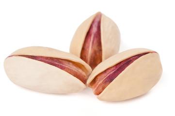 Three pistachios on white