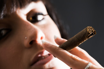 beautiful girl smoking a cigar