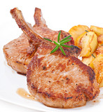 Juicy grilled pork fillet steak with fried apple slices