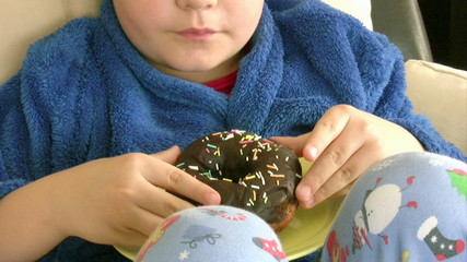 Boy likes chocolate donut