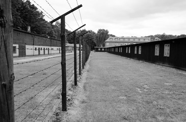Barbed wire fence and barracks in concentration camp Stutthof