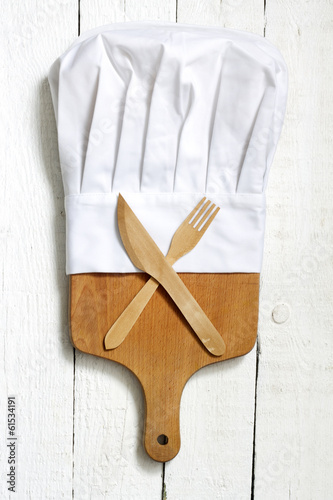 Chef hat and empty cutting board abstract food background